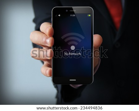 business and mobility communications concept: businessman holding a modern smartphone with no network icon - stock photo