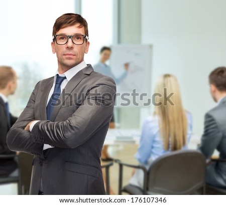 business and office concept - attractive buisnessman or teacher in eyeglasses at office - stock photo