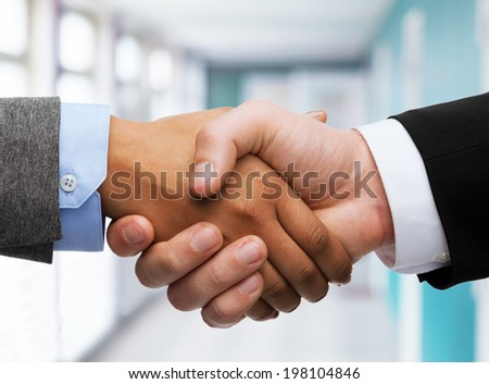 business and office concept - businessman and businesswoman shaking hands in office - stock photo