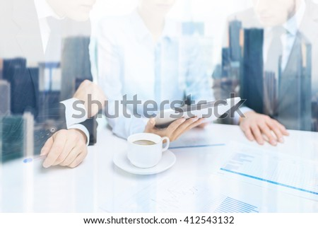 business and office concept - close up of business team with chart, graph, tablet pc and coffee