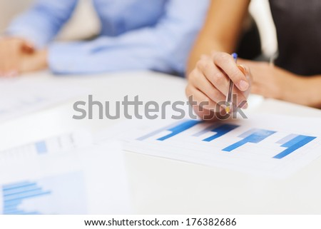 business and office concept - close up of chats and graphs in office - stock photo
