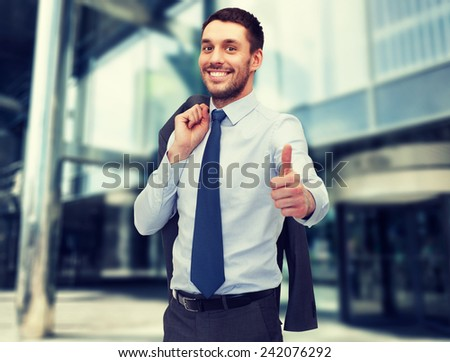 business and office concept - handsome buisnessman with jacket over shoulder showing thumbs up - stock photo