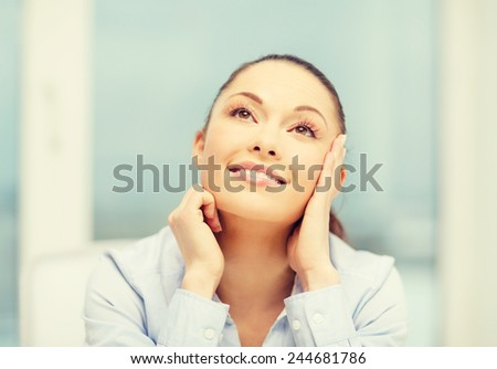 business and office concept - smiling businesswoman dreaming in office - stock photo