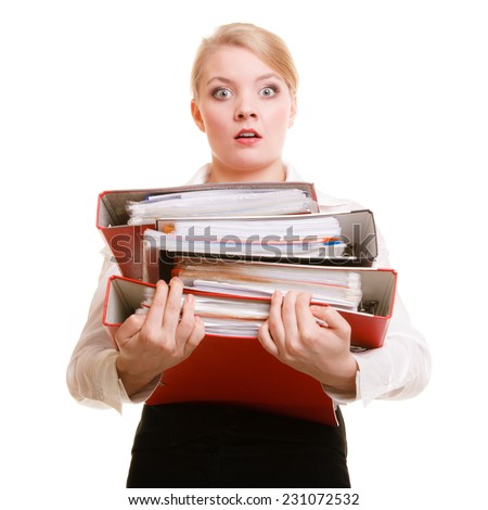 Business and paperwork. Young overworked businesswoman holding stack of folders documents. Busy woman working in office.