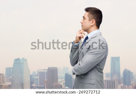 business and people concept - thinking businessman in suit making decision over city background - stock photo