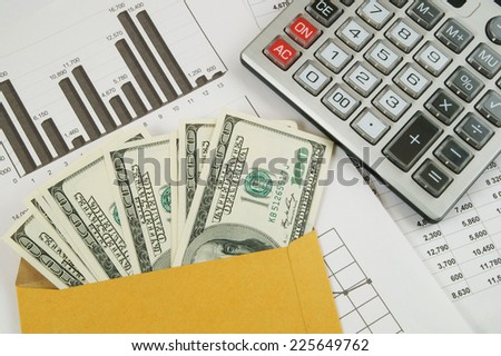 Business and profits concept with calculator, money in envelope and documents  - stock photo
