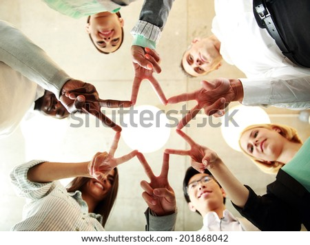 business and succcess concept - group of businesspeople showing v-sign together - stock photo