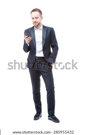 Business and technology. Full length of confident young man in suit using smart phone. Isolated on white. - stock photo