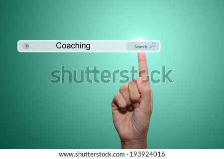Business and technology, searching system and internet concept - male hand pressing Search Coaching button.  - stock photo