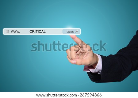 Business and technology, searching system and internet concept - male hand pressing Search CRITICAL button.