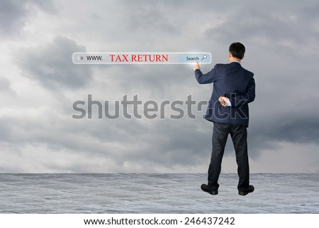 Business and technology, searching system and internet concept - male hand pressing Search TAX RETURN - stock photo
