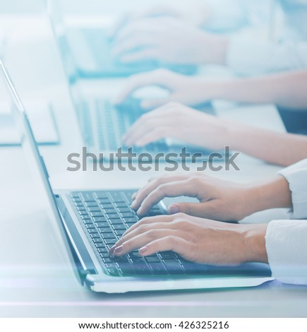 business and telemarketing concept - group of people working with laptops in office
