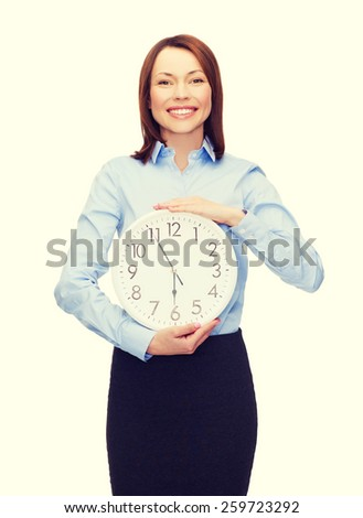 business and time concept - attractive businesswoman with wall clock - stock photo