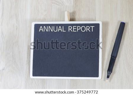 business  annual report blank list memo written on a blackboard with pen - stock photo