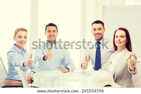 business, architecture and office concept - happy team of architects and designers in office showing thumbs up - stock photo