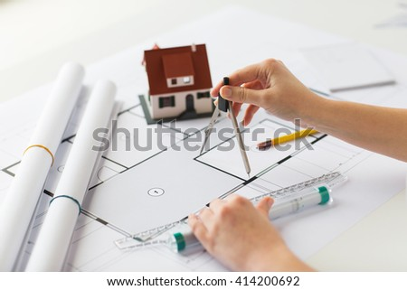 business, architecture, building, construction and people concept - close up of architect hands with compass and ruler measuring living house blueprint - stock photo