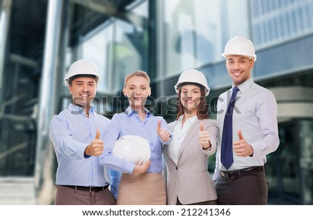 business, architecture, teamwork, gesture  and office concept - happy team of architects in office showing thumbs up - stock photo