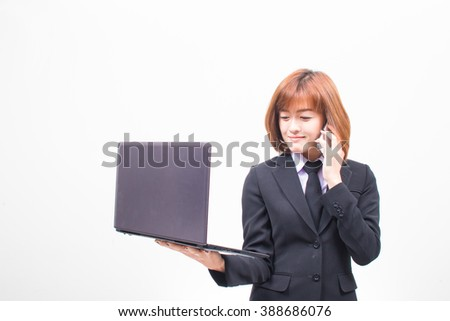 Business asian woman talking on her mobile phone