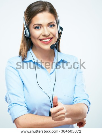 Business assistant. Call center  woman operator show thumb up. Smiling girl isolated portrait. - stock photo