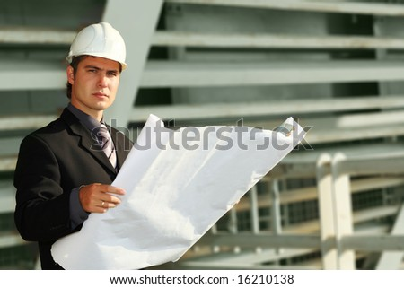 Business background: builder standing at building site. - stock photo