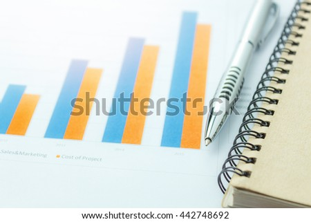 business background concept the pen and notepaper on business chart or documents background . - stock photo