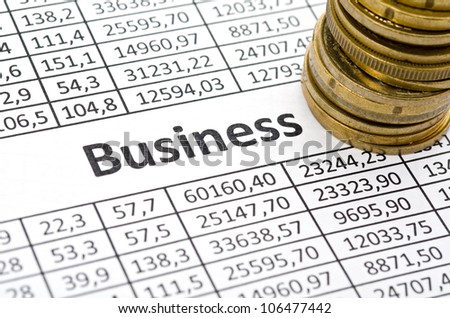 Business background, euro coins on stock chart. - stock photo