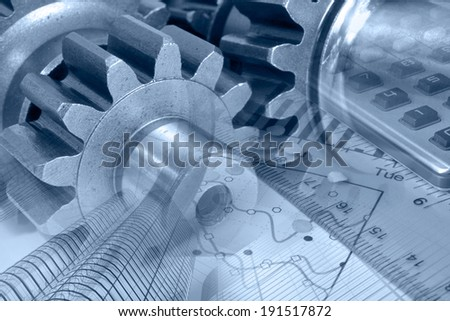 Business background in blues with ruler, gear and graph. - stock photo