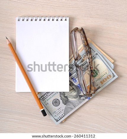 business background, paper money, glasses and pencil - stock photo