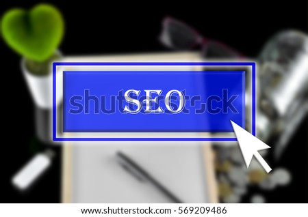Business background with blue button, mouse icon and text written SEO