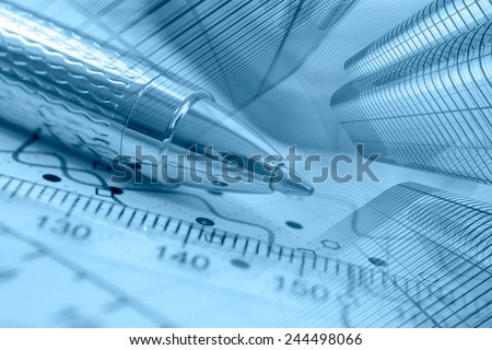 Business background with graph, buildings and pen, blue toned. - stock photo