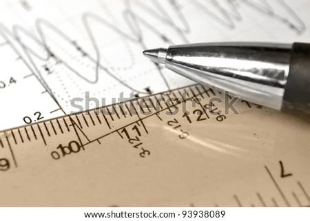 Business background with graph, ruler, pen and calculator, in sepia. - stock photo