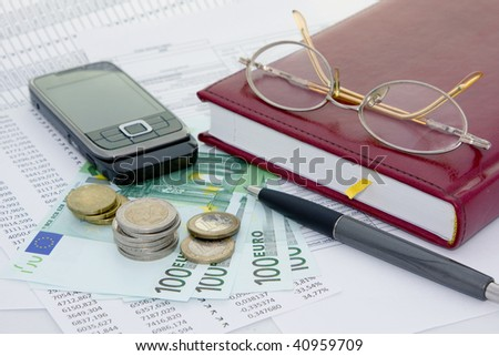 Business background with money and telephone - stock photo
