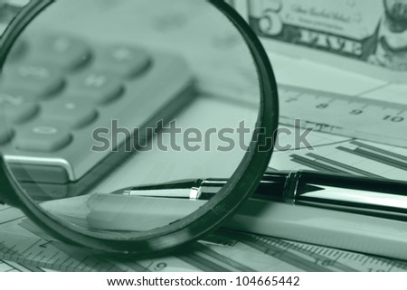 Business background with money, magnifier and pen, in greens.