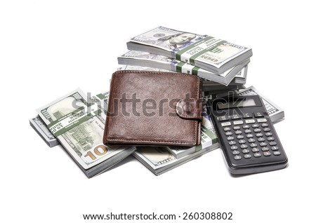 Business background with office tools and a stack of money packs of new one hundred United States Dollar bills ($100 USD) isolated on white background - stock photo