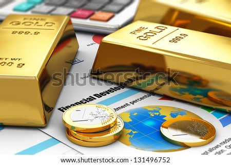 Business banking and financial success concept: gold ingots, coins and office calculator on colorful financial report documents with graphs, charts and stock market exchange data - stock photo