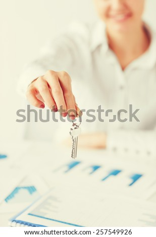 business, banking, real estate concept - woman hand holding house keys - stock photo