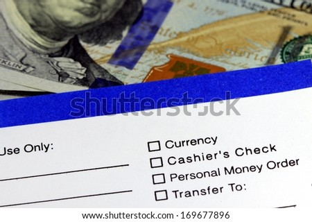 Business banking transfer slip with US currency - stock photo