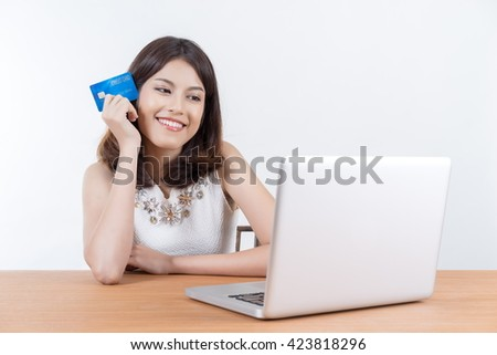 Business, beautiful woman shopping online with laptop and credit card, sale and business concept, soft focus