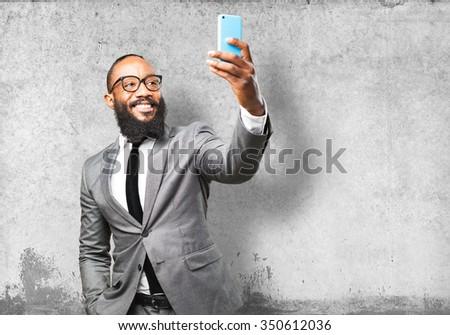 business black man taking a selfie - stock photo