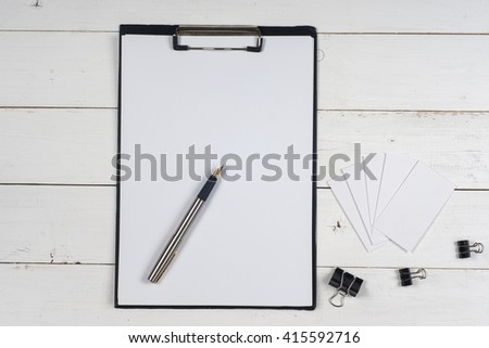 Business blank, notepad and pen at office desk table top view. Corporate stationery branding mock-up - stock photo