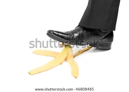 Business boot to step on a banana skin on a white - stock photo
