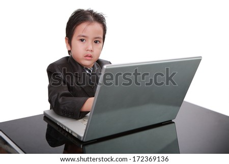Business boy working on laptop, white background; Thailand - stock photo