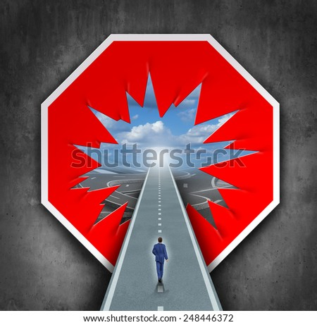 Business breakthrough and overcoming road blocks as a red and white stop sign with a hole revealing a path for a person to walk towards career or life success. - stock photo