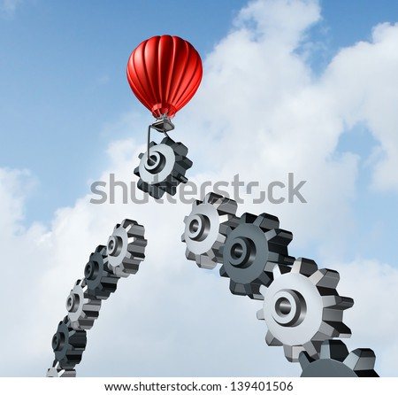 Business bridge building with a red hot air balloon lifting a gear up to the sky to construct and complete a bridged chain of cogs connected together as a result of strategy and planning for success. - stock photo