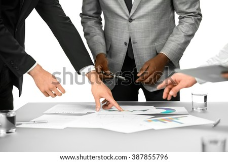 Business briefing in office. Work needs to be done. All this data is important. Don't loose you concentration. - stock photo