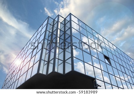 Business building against the blue sky and beautiful clouds - stock photo