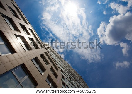 business building and blue sky - stock photo