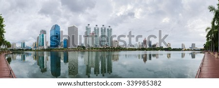 Business building and residential building in bangkok seen from Benjakiti park, Thailand. panorama picture. - stock photo