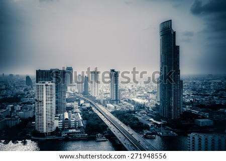 Business Building Bangkok city area at twilight scene with transportation car and ship as panorama, high angle bird eyes view - stock photo
