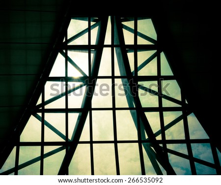 Business building interior, sunburst over building roof,structure pattern. - stock photo